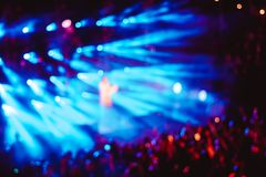 Searchlights at a concert. Stage lights on concert. Lighting equipment with multicolored beams Royalty Free Stock Image