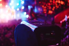 Searchlights at a concert. Stage lights on concert. Lighting equipment with multicolored beams Royalty Free Stock Images