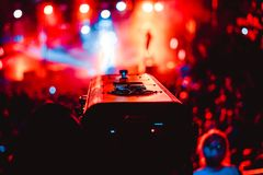 Searchlights at a concert. Stage lights on concert. Lighting equipment with multicolored beams Stock Photography