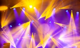Stage lights on concert. Lighting equipment. With multi-colored beams Stock Images