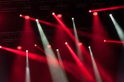 Stage lights on concert. Lighting equipment. With multicolored beams Stock Images