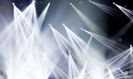 Stage lights on concert. Lighting equipment. With white colored beams Stock Photography