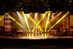 Stage Lights Before Concert. Stage lights before start of concert with multiple musical instruments and microphones royalty free stock photography