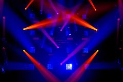 Colorful stage light background. Stage lights of different colors, background of glowing blue and red spotlights stock photography