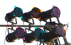 Stage Lights and Effects. Multi-colored spotlights are mounted on metal poles stock photos