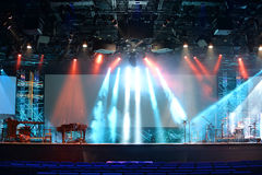 Stage Lights With Musical Instruments. Stage lights with cross and communion trays in foreground royalty free stock image