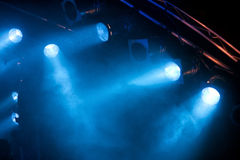Stage lights. Several blue stage lights in the dark Stock Image
