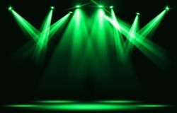 Stage lights. Several projectors in the dark. Green spotlight strike through the darkness royalty free illustration
