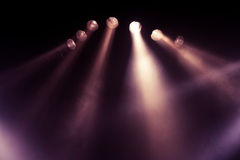 Stage lights. Several purple stage lights in the dark Royalty Free Stock Images