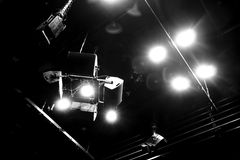 Stage lights. Shining stage lights in black and white stock images