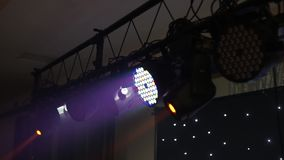 Stage lights shining at studio. Seamless looping animation. HD stock video footage