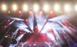 Stage lights and smoke on concert. Stage lights and colorful smoke on electric concert Royalty Free Stock Images