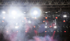 Stage lights and smoke on concert. Stage lights and colorful smoke on electric concert Royalty Free Stock Photo