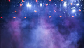 Stage lights and smoke on concert. Stage lights and colorful smoke on electric concert Royalty Free Stock Photos