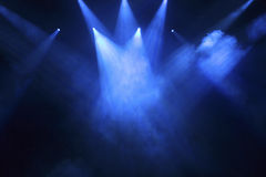 Stage lights. Spotlights that illuminate the stage at a concert with fog royalty free stock image