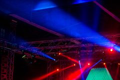 Stage lights on metal construction during a concert. Stage lights and spotlights on metal construction during a concert Royalty Free Stock Photo