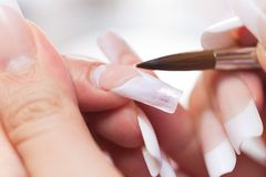 Stage of manicure: modeling of nail with acryl Royalty Free Stock Photos