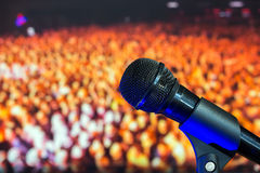 Stage microphone in the background of the crowd Royalty Free Stock Images