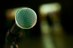 Stage microphone close up. Close up detail of stage microphone on blurry background royalty free stock photos