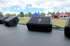 On stage before music festival. Black speaker monitors Stock Photography