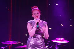 On stage, the musicians pop-rock group Spearmint and singer Anna Malysheva. Red headed Glam Rock Girl singing. Stock Photography