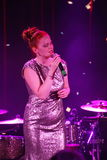 On stage, the musicians pop-rock group Spearmint and singer Anna Malysheva. Red headed Glam Rock Girl singing. Royalty Free Stock Images