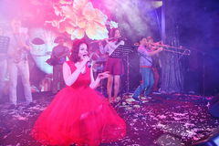 On stage, the musicians pop-rock group Spearmint and singer Anna Malysheva. Red headed Jazz Rock Girl singing. Royalty Free Stock Image