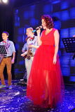 On stage, the musicians pop-rock group Spearmint and singer Anna Malysheva. Red headed Jazz Rock Girl singing. Royalty Free Stock Photo