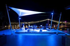 Stage, outdoor music on the beach by the sea at night.  stock image