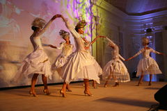 Stage performance of upscale restaurant the summer palace dancers dance show of the ensemble group style. Royalty Free Stock Image