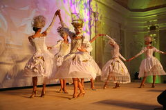 Stage performance of upscale restaurant the summer palace dancers dance show of the ensemble group style. Stock Image