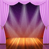 Stage with pink curtains and spotlight. Royalty Free Stock Photography