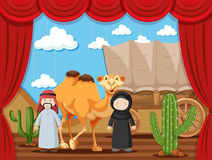 Stage play with two people playing arabs in desert Royalty Free Stock Image