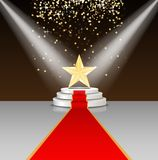 Stage podium with red carpet and star on brown background Royalty Free Stock Image