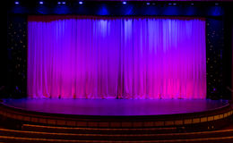 Stage with Purple Curtains Royalty Free Stock Photos