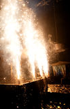 Stage Pyrotechnics. An abstract view of a stage letting off sparkling pyrotechnics on a dark background Royalty Free Stock Photo