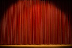 Stage with red curtain. Empty stage before or after the show, with closed red curtain Stock Images