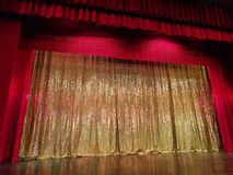 Stage with red curtain - golden shiny in the middle. Framed by red stock images