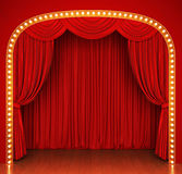 Stage with red curtain and lights Royalty Free Stock Photography