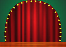 Stage with red curtain, lights and wooden floor. Royalty Free Stock Photos