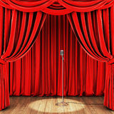 Stage with red curtain, retro microphone and wooden floor Stock Image