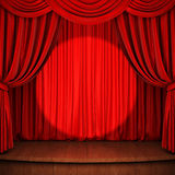 Stage with red curtain, wooden flooring and spot light Royalty Free Stock Photography