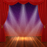 Stage with red curtains and spotlight. Stock Image