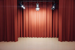 Stage with red scenes and spotlights Royalty Free Stock Photo
