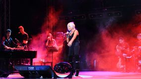 Stage with red smoke. ISTANBUL - SEPTEMBER 18: Pop star Ajda Pekkan performs live during a concert at Maltepe on September 18, 2011 in Istanbul, Turkey Stock Image