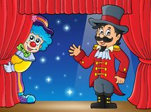Stage with ringmaster and lurking clown Royalty Free Stock Photography