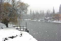 Stage and river in snowstorm Royalty Free Stock Photography
