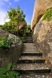 Stage among rocks. Path and stage extend among rocks, shown as landscpe and view, and refer as approach, access, way and method Royalty Free Stock Images