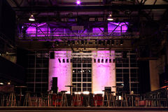 The Stage Is Set. Indoor Entertainment Venue ready for your performance. Setup includes Stage, Lights, Speakers, Chairs and Tables royalty free stock photos