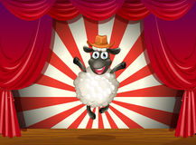 A stage with a sheep jumping at the center Stock Photo